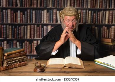 Mature judge in court consulting law books