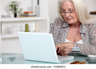A mature lady doing online shopping.