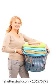 Mature lady holding a laundry basket isolated on white background