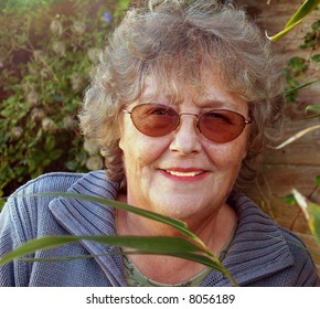 Mature lady working in the garden enjoying her leisure