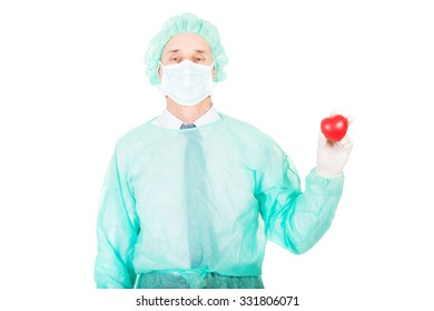 Mature male doctor holding heart model.