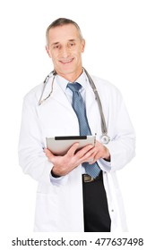 Mature male doctor using a tablet