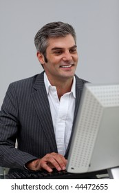 Mature male executive working at a computer in the office