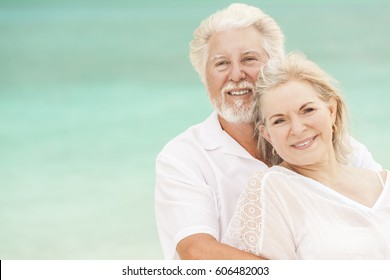 Mature male female Caucasian couple in love living a healthy outdoor leisure lifestyle on a Caribbean beach