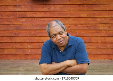 Mature male senior expressions outdoors.