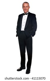 A mature male wearing a black tuxedo and bow tie, isolated on a white background.