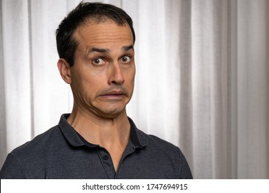 Mature man (44 years old) making a face that did something very wrong.