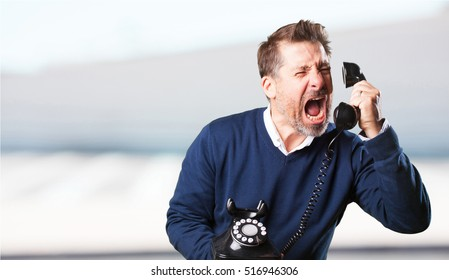 mature man angry talking on telephone