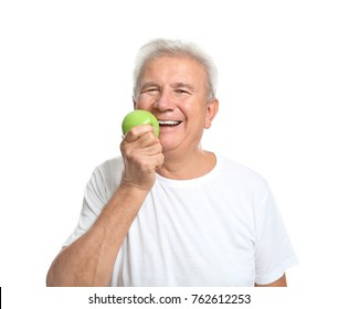 Mature man with apple on white background
