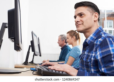 Mature Man Attending Computer Class In Front Of Screen