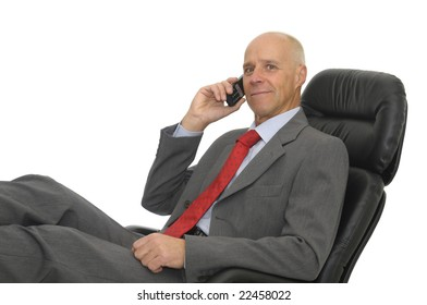 Mature man with cellphone isolated in white