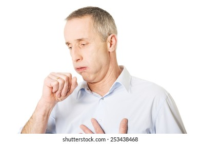Mature man coughing because of flu.