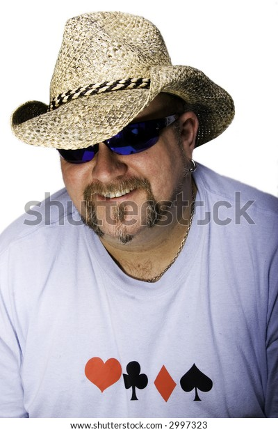 A mature man in a cowboy hat sunglasses and tshirt