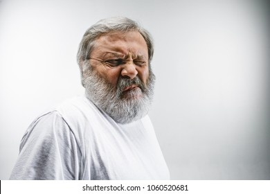 Mature man with disgusted expression repulsing something. Disgust concept. Young emotional man. Human emotions, facial expression concept. Studio.