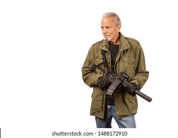 Mature man, Doomsday prepper with AR15 style rifle.
