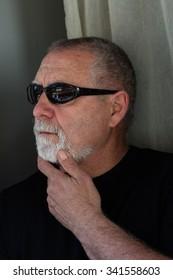mature man dressed in black