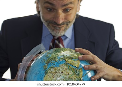 mature man  with earth globe over white background