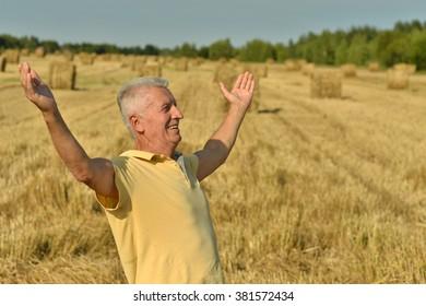 Mature man enjoying fresh air on nature