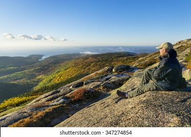 Mature Man Enjoying View from Mountain