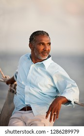 Mature man enjoying view of the water from a boat.