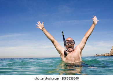 A mature man excited about Australian beach holiday.