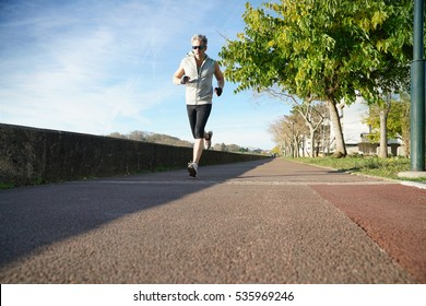 Mature man exercising outside in the morning