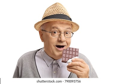 Mature man having a bite out of a chocolate bar isolated on white background