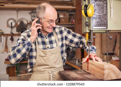 Mature man having a work accident on a band saw