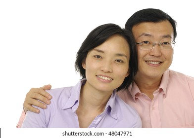 mature man with his arms around his beautiful wife