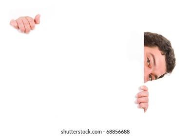 Mature man holding a blank billboard