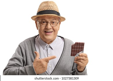 Mature man holding a chocolate bar and pointing isolated on white background
