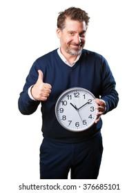 mature man holding a clock