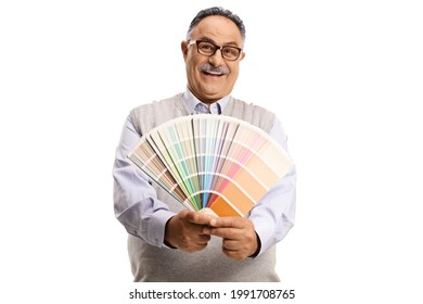 Mature man holding a color palette and looking at the camera isolated on white background