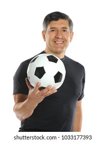 Mature man holding a soccer ball isolated on a white background