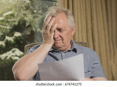 Mature man looking stressed and upset after reading a letter