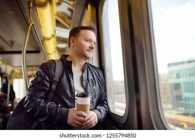 Mature man looks out the window of the car in the subway in new York. Transport of New York.