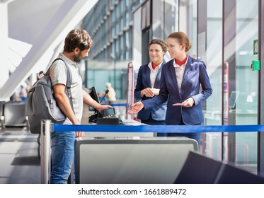 Mature man on board scanning her ticket on smartphone in airport