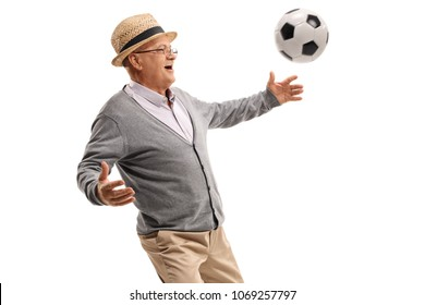 Mature man playing with a football isolated on white background