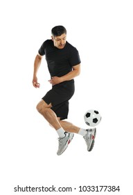 Mature man playing with soccer ball isolated on a white background