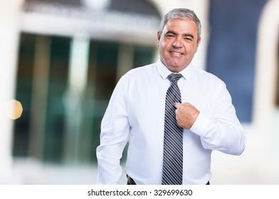 mature man pointing himself