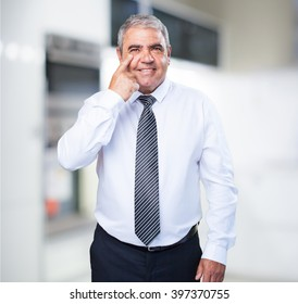 mature man pointing his eye