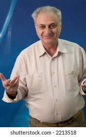 Mature man portrait. He is looking strait at the camera and gesturing