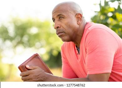 Mature man reading and thinking.