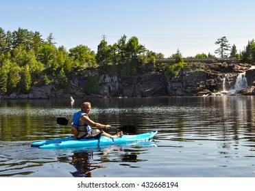 Mature man in a recreational kayak