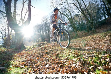 Mature man riding bike in the mountain