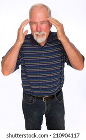A mature man rubbing his temples for headache pain relief