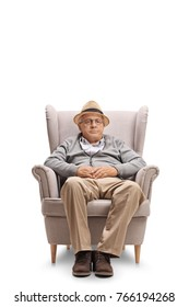 Mature man seated in an armchair isolated on white background