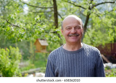 Mature man sitting in countryside