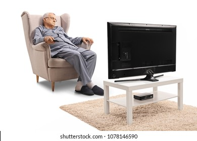 Mature man sleeping in an armchair in front of a television isolated on white background