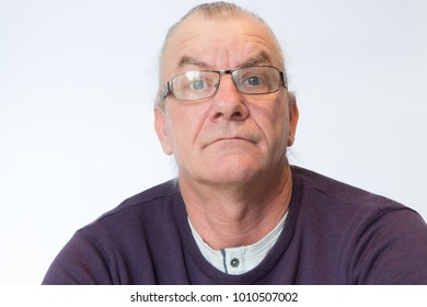 mature man with surprised and shocked expression on his face. studio white background
